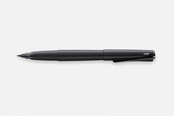 a 2019 special edition, all black, lamy studio fountain pen on a grey background